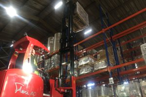 Flexi truck loading pallet onto racking