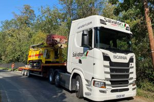 salvatori lowloader trailer carrying digger